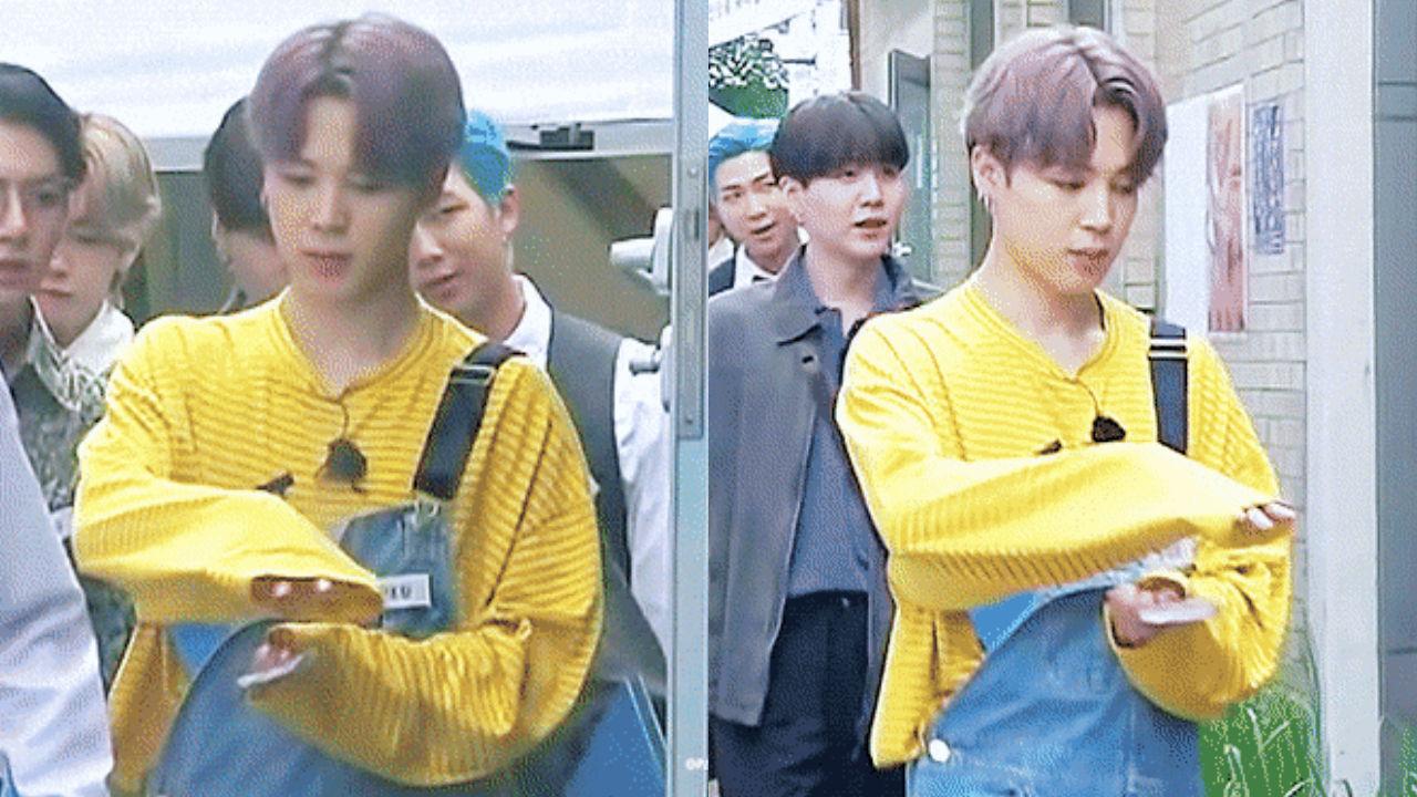 """기사 대표 이미지:[SBS Star] Fans Cannot Stop Going """"Aww"""" Over the Way JIMIN Tries to Protect His Lollipop from Rain"""